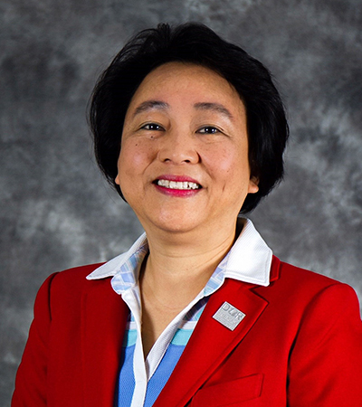 cindy chiu wearing a red blazer over a blue shirt with white collar